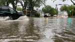 Cars driving through the intersection of Victoria Avenue and Elphinstone Street had to deal with several inches of water after a rainstorm on June 11, 2021. (Gareth Dillistone/CTV News)