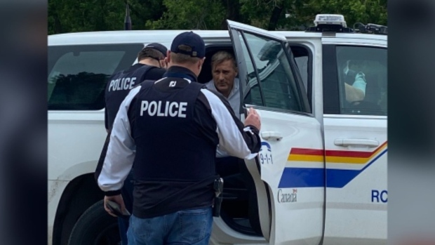 Maxime Bernier, leader of the People's Party of Canada, is arrested by RCMP outside of outside of St-Pierre-Jolys, Man. after speaking at a rally on June 11, 2021. (Image source - Twitter: Nicole Buffie @nicbufflin/Photo courtesy Steinbach Carillon)