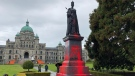 A group of protesters vandalized a statue of Queen Victoria at the B.C. legislature on Friday. (CTV News)