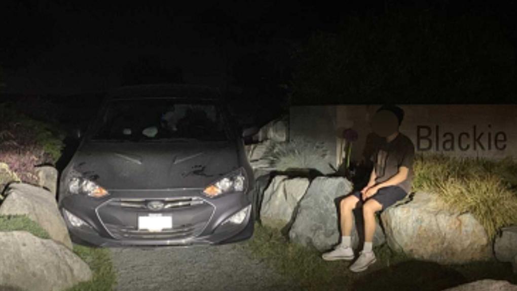 Car wedged between boulders