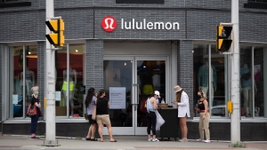 People line up outside a Lululemon Athletica store in Ottawa, as non-essential retail stores re-open with limited in-store capacity, on the first day of Ontario's first phase of re-opening amidst the third wave of the COVID-19 pandemic, on Friday, June 11, 2021. (Justin Tang /THE CANADIAN PRESS)