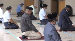 A man prays silently during a special commemoration at the the Maryam Mosque in Oro-Medonte, Ont. on Fri. June 11, 2021 (Siobhan Morris/CTV News)