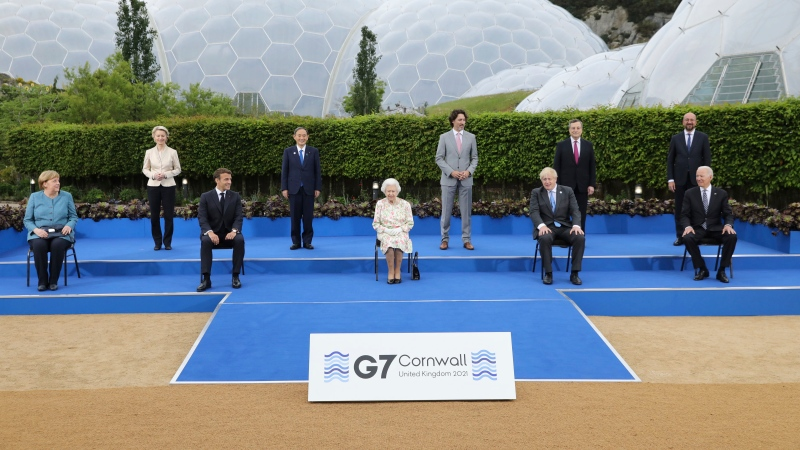 Queen Elizabeth II poses for a group photo with G7 leaders, from left, back row, President of the European Commission Ursula von der Leyen, Japan's Prime Minister Yoshihide Suga, Canada's Prime Minister Justin Trudeau, Italy's Prime Minister Mario Draghi and President of the European Council Charles Michel, from left, front row, German Chancellor Angela Merkel, French President Emmanuel Macron, Britain's Prime Minister Boris Johnson and US President Joe Biden before a reception at the Eden Project in Cornwall, England, Friday June 11, 2021, during the G7 summit. (Jack Hill/Pool via AP)