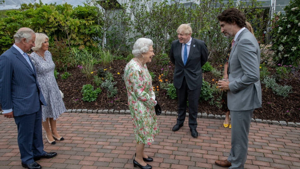 Queen Elizabeth II, centre speaks with Prime Minister Boris Johnson and Canadian Prime Minister Justin Trudeau at a reception for the G7 leaders at the Eden Project in Cornwall, England, Friday June 11, 2021, during the G7 summit. Prince Charles and Camilla, the Duchess of Cornwall stand on the left. (Jack Hill/Pool via AP)