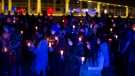 Attendees hold candles during a vigil in Toronto on Friday, June 11, 2021, to honour the four members of a Muslim family that were killed in London, Ont., on Sunday in what police called a hate crime. THE CANADIAN PRESS/Chris Young