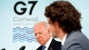 U.S. President Joe Biden listens as Canadian Prime Minister Justin Trudeau speaks during the G7 summit at the Carbis Bay Hotel in Carbis Bay, St. Ives, Cornwall, England, Friday, June 11, 2021. (Kevin Lamarque/Pool via AP)