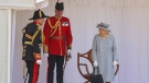 Britain's Queen Elizabeth II watches a military ceremony to mark her official birthday at Windsor Castle, Windsor, England, Saturday June 12, 2021. (Chris Jackson/Pool via AP)