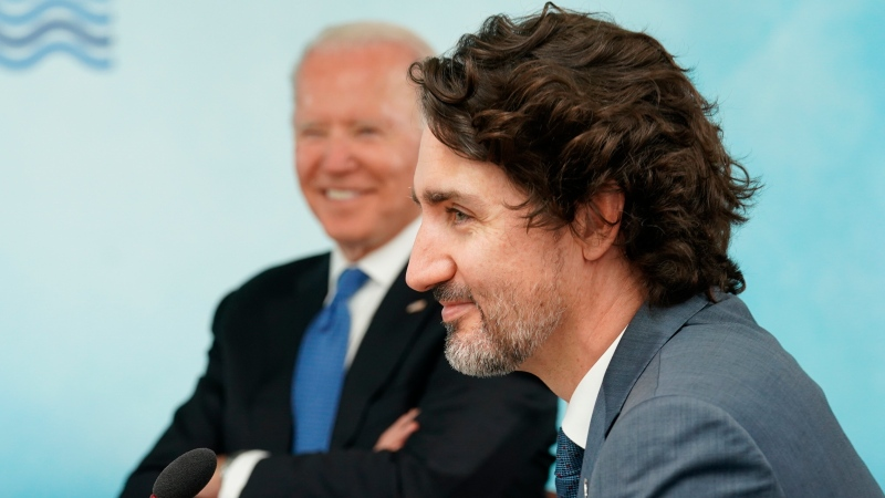 U.S. President Joe Biden and Canadian Prime Minister Justin Trudeau attend the G7 summit at the Carbis Bay Hotel in Carbis Bay, St. Ives, Cornwall, England, Friday, June 11, 2021. (Kevin Lamarque/Pool via AP)