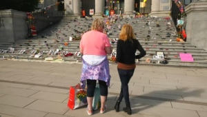 Cheryle Gunargie, right, is a residential school survivor who has been sharing her story with people who visit the memorial for the children who died at the Kamloops Indian Residential School, currently set up on the steps of the Vancouver Art Gallery.