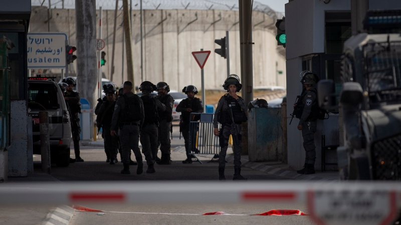 Members of the Israeli forces gather at the site where a woman was shot and killed at the Qalandia checkpoint between Jerusalem and the West Bank city of Ramallah, Saturday, June 12, 2021. (AP Photo/Majdi Mohammed)