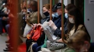 People wearing face mask to help curb the spread of the coronavirus ride a subway car in Moscow, Russia, Thursday, June 10, 2021. The Russian authorities reported a spike in coronavirus infections on Thursday, with new confirmed cases exceeding 11,000 for the first time since March. (AP Photo/Alexander Zemlianichenko)