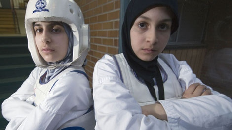Zeinab Nasser (left), 13, and Bissan Mansour, 11, are two of seven Muslim girls who were denied the right to compete in a taekwondo tournament wearing their hijabs, in Montreal�s south shore Sunday April 15, 2007. (CP PHOTO/ Peter McCabe)