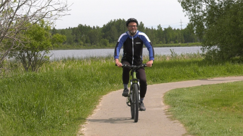 Michael Thoerner of Timmins enjoys walking, running and now cycling.  He's signed up for the Great Cycle Challenge as a way of paying back for all the help he's received along the way on his health journey.  His coach, Lisa Tremblay of Discover Fitness/Discover Performance said she's humbled by his perseverance despite his obstacles. June 12/21 (Lydia Chubak/CTV News Northern Ontario)