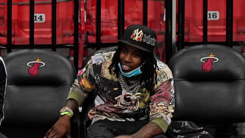 In this April 18, 2021 photo, Rapper Polo G watches during the second half of an NBA basketball game between the Miami Heat and the Brooklyn Nets in Miami. (AP Photo/Wilfredo Lee, File)