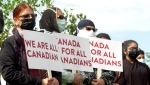 A large group of Calgarians demonstrated in the city on Saturday against the growing number of hate-motivated crimes and incidents.