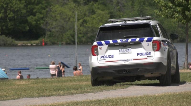 An Ottawa Police Service cruiser drives through Mooney's Bay Park amid increased public health enforcement. (Colton Praill/CTV News Ottawa)