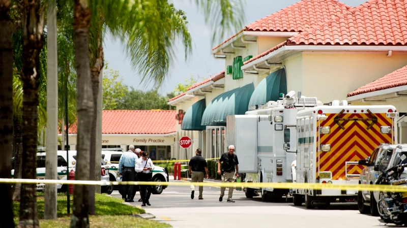 Police gather at the Publix shopping center at the scene of a shooting in Royal Palm Beach, Fla., on Thursday, June 10, 2021. (Greg Lovett /The Palm Beach Post via AP)