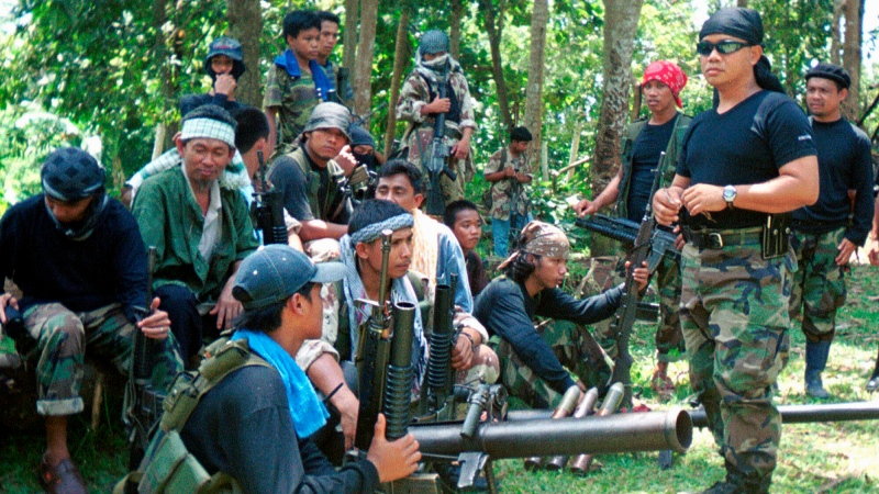 This undated file photo shows a group of armed Abu Sayyaf members. (AP Photo, File)