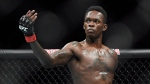 In this Feb. 10, 2019, file photo, Nigeria's Israel Adesanya poses as he fights Brazil's Anderson Silva in their middleweight bout at the UFC 234 mixed martial arts fights in Melbourne, Australia. (AP Photo/Andy Brownbill, File)
