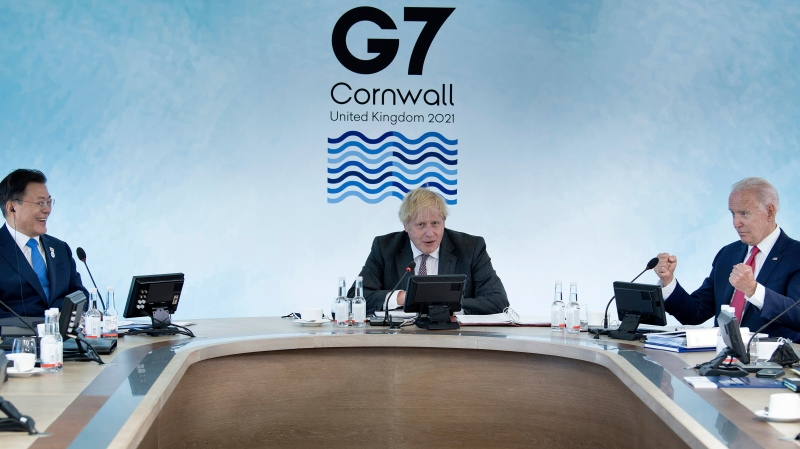 South Korea's President Moon Jae-in, left, and U.S. President Joe Biden, right, listen to Britain's Prime Minister Boris Johnson during a working session at the G7 summit in Carbis Bay, Cornwall, England, Saturday, June 12, 2021. (Brendan Smialowski/Pool Photo via AP)