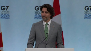 Prime Minister Justin Trudeau speaking to reporters at the G7 summit on Sunday.