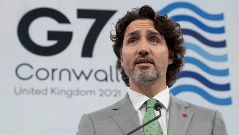 Prime Minister Justin Trudeau holds a closing news conference at Treganna castle following the G7 Summit in St. Ives, Cornwall, England, on Sunday, June 13, 2021. (THE CANADIAN PRESS / Adrian Wyld)