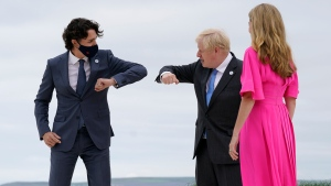 British Prime Minister Boris Johnson and his wife Carrie Johnson greet Prime Minister Justin Trudeau before posing for photos at the G-7 summit, Friday, June 11, 2021, in Carbis Bay, England. (AP Photo/Patrick Semansky, Pool)