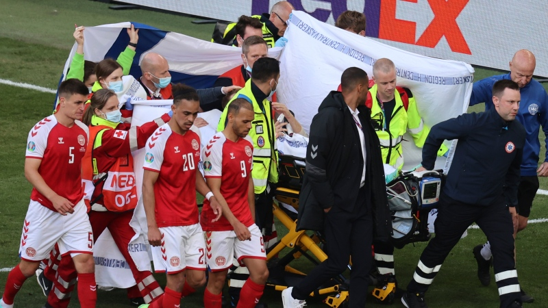 Paramedics using a stretcher to take out of the pitch Denmark's Christian Eriksen after he collapsed during the Euro 2020 soccer championship group B match between Denmark and Finland at Parken stadium in Copenhagen, Denmark, Saturday, June 12, 2021. (Wolfgang Rattay/Pool via AP)