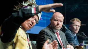 Quebec Minister Responsible for Indigenous Affairs, Ian Lafreniere, centre, and federal Minister of Indigenous Services, Marc Miller, right, look as Mohawk elder Kevin Deer speaks during a news conference in Montreal, Saturday, June 12, 2021. The Quebec and federal governments are appointing a point person to help Quebec Indigenous communities retrieve information on former residential schools in the province. THE CANADIAN PRESS/Graham Hughes