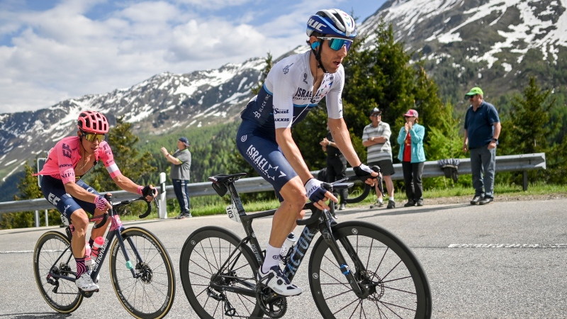 Michael Woods from Canada of Israel Start-Up-Nation, right, climbs the Lukmanier pass ahead of Rigoberto Uran from Colombia of Ef Education-Nippo during the sixth stage, a 130 km race from Andermatt to Disentis-Sedrun, at the 84th Tour de Suisse UCI ProTour cycling race, on Friday, June 11, 2021. (Gian Ehrenzeller/Keystone via AP)