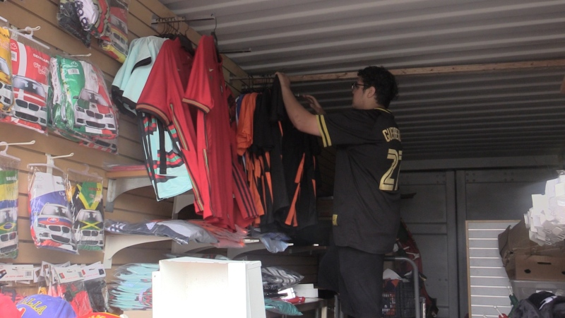 Amjad Abdul Hamid sets up his trailer full of soccer gear on Highbury Ave in London, Ont. Sunday June 13, 2021. (Brent Lale/CTV London)