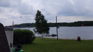 A helicopter could be seen flying over Conestogo Lake following reports of a missing person in the water. (Matt Ethier/CTV Kitchener) (June 13, 2021)