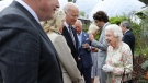 Queen Elizabeth II speaks with US President Joe Biden and US First Lady Jill Biden and leaders of the G7 during a reception at The Eden Project in south west England on June 11.