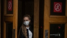 A woman wearing a face mask exits a metro station in Moscow, Russia, Thursday, June 10, 2021. (AP Photo/Pavel Golovkin)