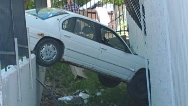 Police and firefighters responded to the scene of a crash after a vehicle collided with the side of an apartment building. (Photo by Virginia Awasis)