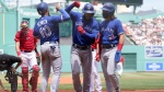 Toronto Blue Jays right fielder Teoscar Hernandez, center right, celebrates with Marcus Semien (10) and Bo Bichette, right, after Hernandez hit a three-run home run in the first inning of a baseball game, as Boston Red Sox's Kevin Plawecki, left, looks on, Sunday, June 13, 2021, in Boston. (AP Photo/Steven Senne)