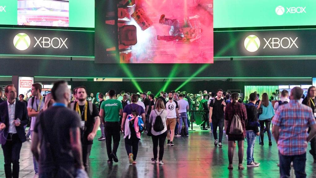 Visitors walk to the microsoft Xbox stand