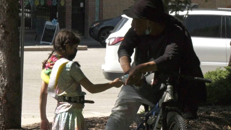 Seven-year-old Zoey Black Plume is doing her part to help those in need during the pandemic by delivering bottles of water to the homeless.