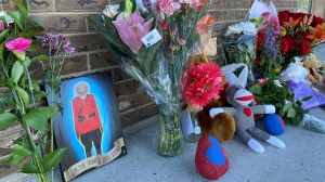 A memorial of flowers grows outside the RCMP detachment in Indian Head, Sask. in memory of Const. Shelby Patton. (Gareth Dillistone / CTV News)