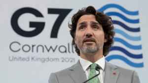 Canadian Prime Minister Justin Trudeau holds a closing news conference at Tregenna Castle following the G7 Summit in St. Ives, Cornwall, England, on Sunday, June 13, 2021. THE CANADIAN PRESS/Adrian Wyld