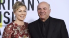 Linda O'Leary and Kevin O'Leary arrive at the American Music Awards at the Microsoft Theater in Los Angeles. (THE CANADIAN PRESS/AP, Jordan Strauss/Invision)
