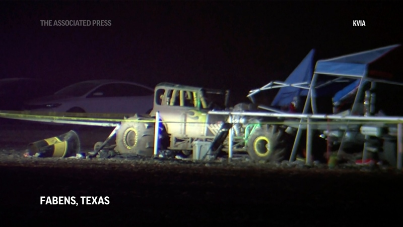 This image from a video, shows cars and tents after a vehicle plowed into a crowd at a mud racing event in Fabens, Texas, Monday, June 14, 2021. KVIA via AP)