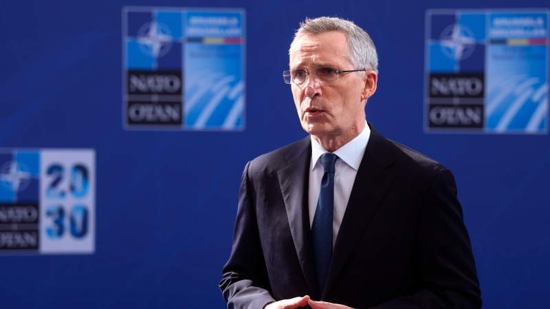 NATO Secretary General Jens Stoltenberg speaks with the media as he arrives for a NATO summit at NATO headquarters in Brussels, Monday, June 14, 2021. (Kenzo Tribouillard, Pool via AP)