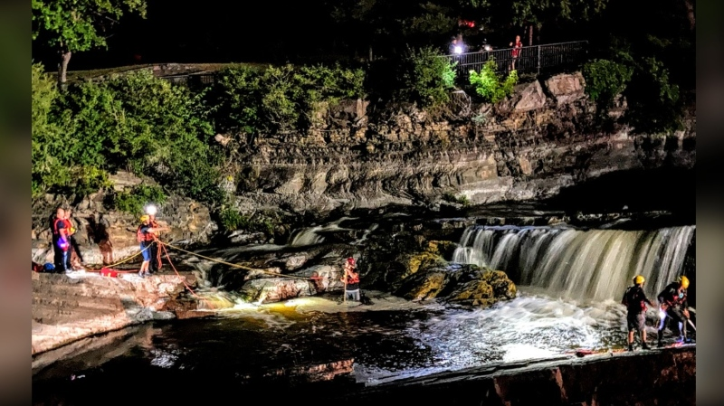 Fire crews rescued a man found clinging to a ledge in the middle of the Rideau River at Hog's Back Falls on Sunday night. (Ottawa Fire Services)