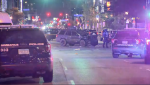 Minneapolis police say two people were taken to the hospital and a woman has died after a car drove into a group of protesters in Uptown late Sunday night. (KARE)