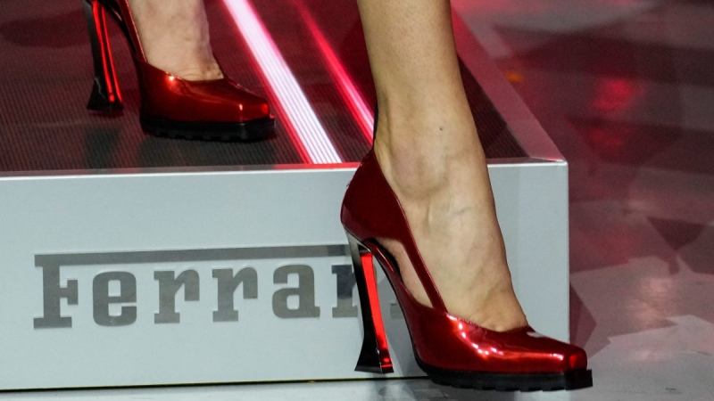 A model wears a creation as part of the Ferrari women's and men's Spring Summer 2022 collection, in Maranello, Italy, on June 13, 2021. (Antonio Calanni / AP)