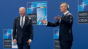 United States President Joe Biden waves after being officially welcomed by Secretary General of North Atlantic Treaty Organization Jens Stoltenberg to the NATO Summit Monday June 14, 2021 in Brussels, Belgium. THE CANADIAN PRESS/Adrian Wyld