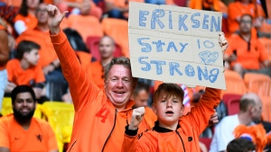 Netherlands supporters hold a placard referring to Denmark's Christian Eriksen before the Euro 2020 soccer championship group C match between Netherlands and Ukraine at the Johan Cruyff ArenA, Amsterdam, Netherlands, on June 13, 2021. (Piroschka van de Wouw / Pool via AP)