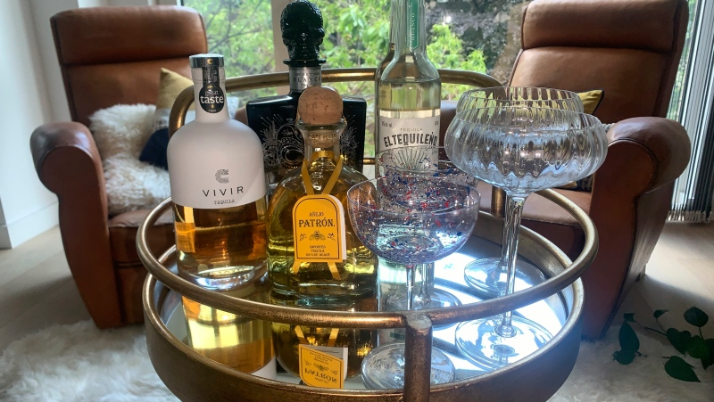 A variety of tequila brands are displayed in London on June 9, 2021. Love it or hate it, tequila conjures up strong feelings in many drinkers. For some, there are bad memories. But today's premium tequilas are changing some of those perceptions. (AP Photo/Louise Dixon)