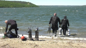 A dive team prepares to search for water hazards. (Mackenzie Read / CTV News)
